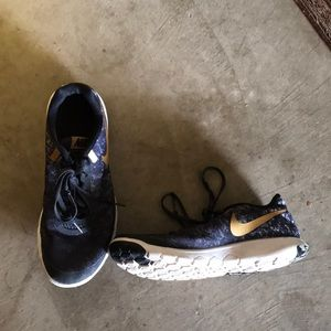 Nike Flex Experience RNG black and gold shoes